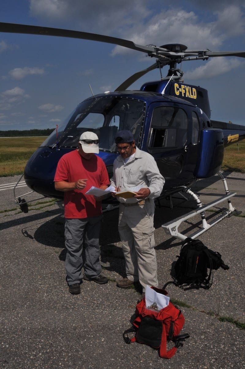 Geologist R. Singh and helicopter