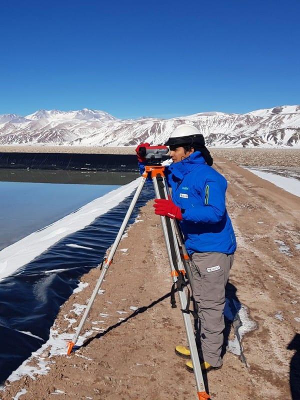 person surveying lithium pond at 3Q