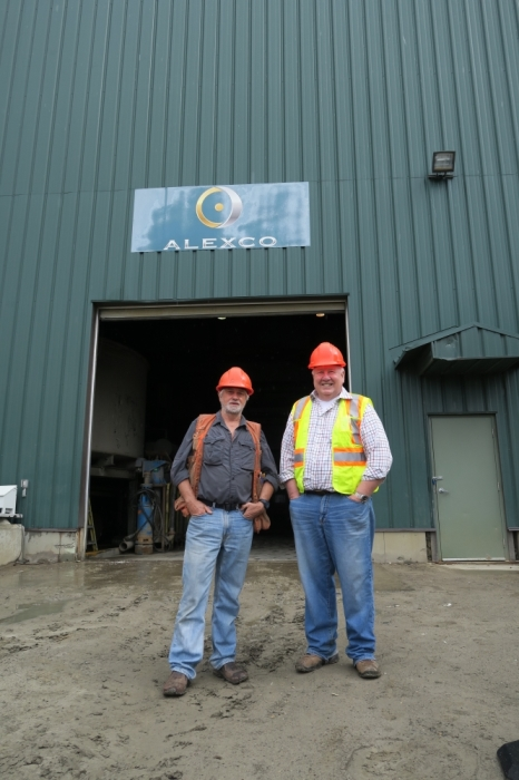 Clynt Nauman and Alexco VP of exploration Alan McOnie in front of Alexco's mill.